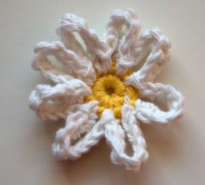 White and yellow crochet daisy