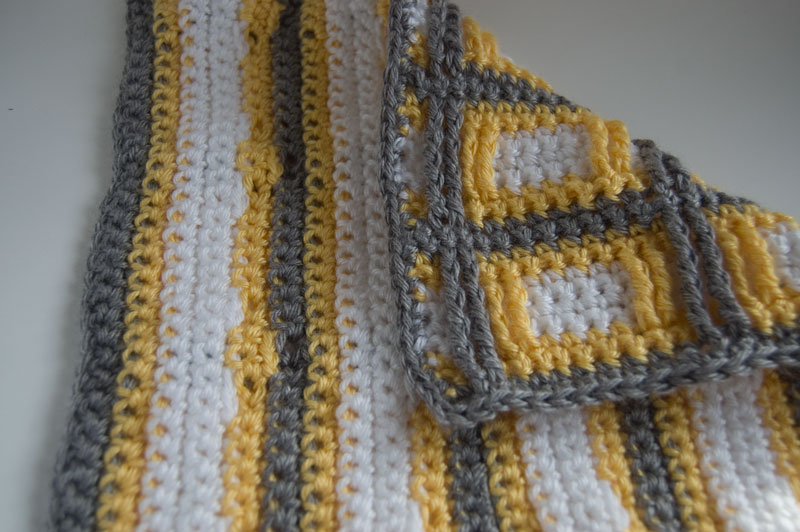 back side of yellow, grey and white Squares Squared Block crochet
