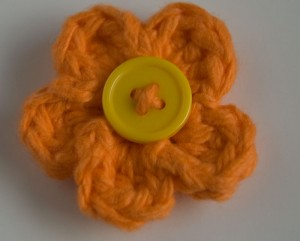 Orange crochet flower hair clip