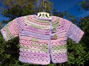 Baby In Bloom Newborn Cardigan - free pattern featuring Broomstick Lace Crochet!