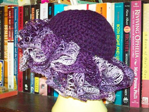 Grape Swirl Hat - ruffle yarns can make more than the twirly scarves! Free pattern!