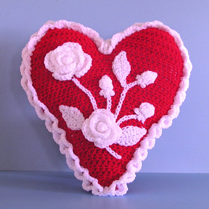 Heart and Flowers Valentine Pillow: Crochet some love for Valentine's Day! Get 10 free #crochet patterns for your Valentine at Moogly!