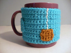 """Cup of Tea"" Coffee Mug Cozy with Non-Slip Backing: Free #crochet mug cozies in a variety of styles in a roundup on Moogly!"