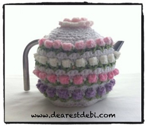 Rose Bud Tea Cozy: Get 10 free #crochet tea cozy patterns... aka tea cosy patterns! :D Roundup of gorgeous patterns at Moogly!