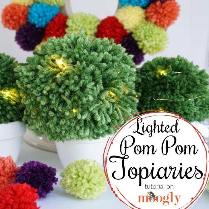 Make Lighted Pom Pom Topiaries for your next event or favorite cozy nook! Tutorial on Mooglyblog.com