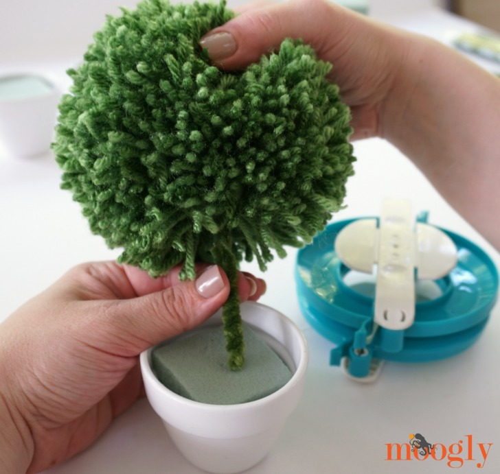 Make Lighted Pom Pom Topiaries for your next event or favorite cozy nook! Tutorial on Mooglyblog.com