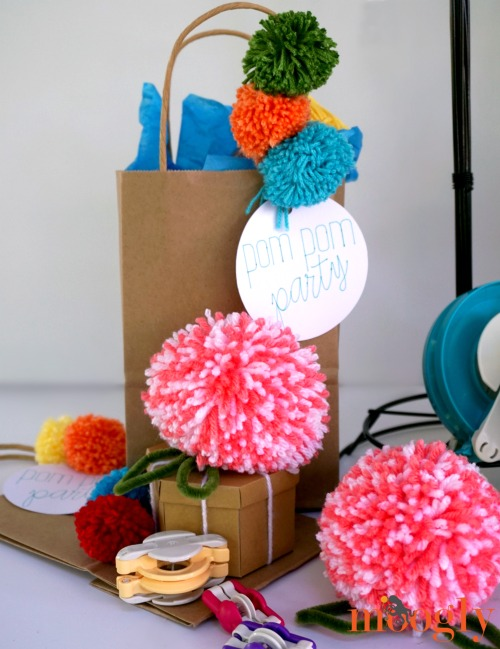 Dress up your gifts with Pom Poms! Ideas and tutorials on Mooglyblog.com!