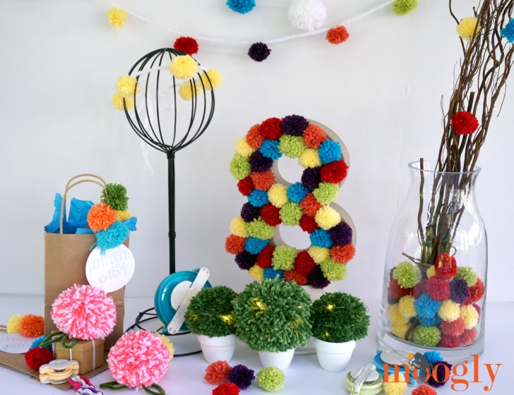 Throw a Kid's Pom Pom Party! Go to Mooglyblog.com, where with Clover Pom Pom Makers you can DIY all the decor and swag you need!