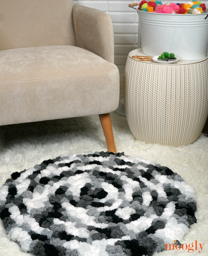Super Easy Non-Slip Pom Pom Rug with a chair and table
