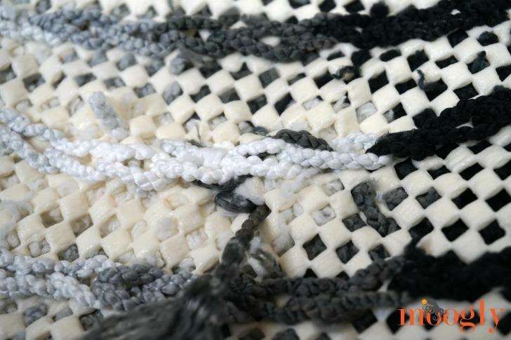 Super Easy Non-Slip Pom Pom Rug - how to weave in the ends of pom pom yarn