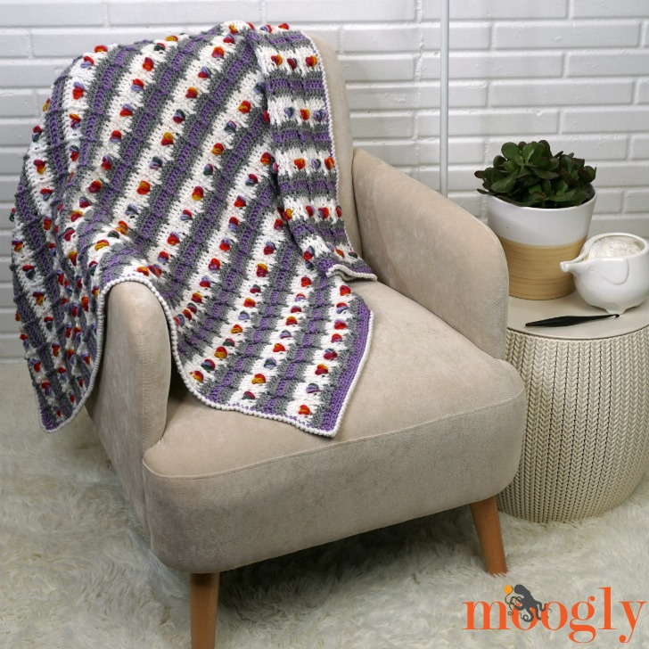 Rows of Love Blanket - on chair,