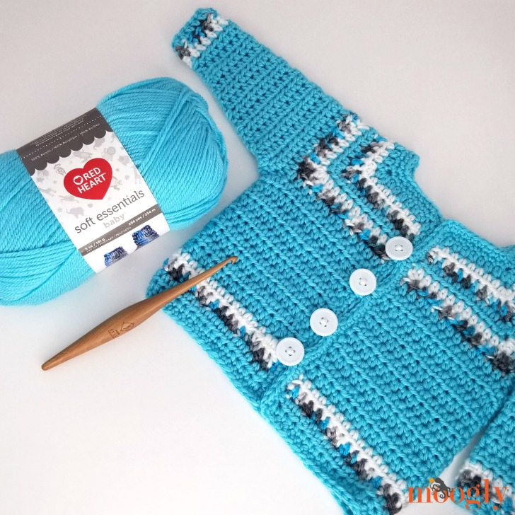 Essential Baby Sweater with yarn and hook