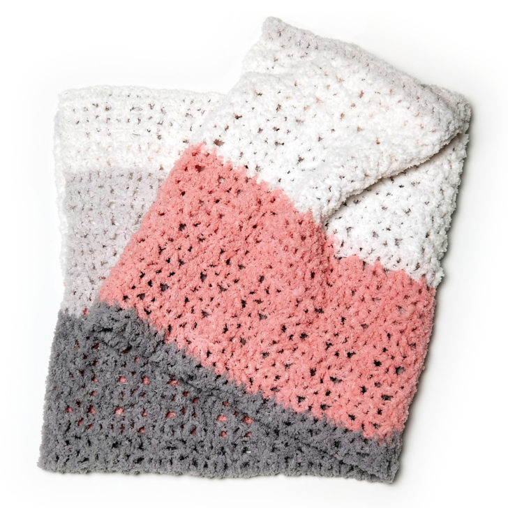 One Ball Easy Striped Baby Blanket - free pattern designed by Moogly for Yarnspirations