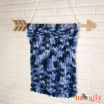 Simple Shibori Knit Pin Banner with no pins, hanging on wall