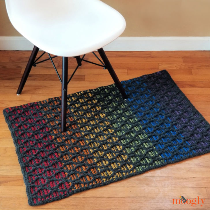 Striped Hourglass Area Rug on floor in front of chair