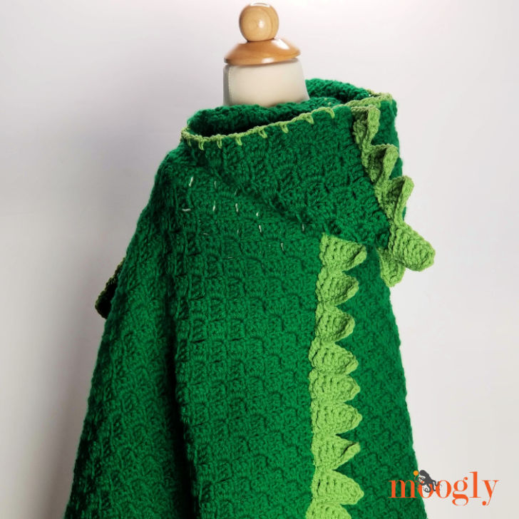 Cuddle Up Dinosaur Blanket - free crochet pattern on Moogly