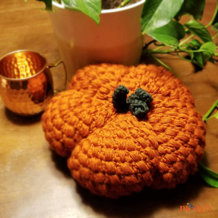 Plush Puff Pumpkin - on table with copper cup and leaves